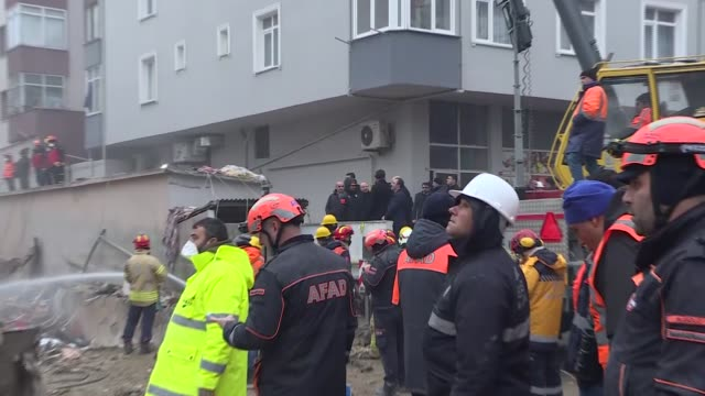 Turkish Interior Minister Suleyman Soylu and Turkey's Health Minister Fahrettin Koca inspect the site of a building collapse as rescue teams work on...