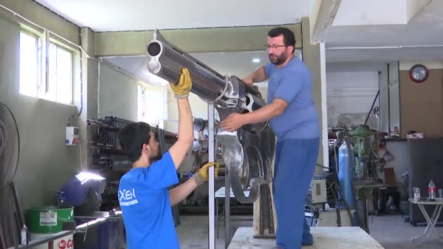turkish kinetic sculptor made 100kg weight giant iron weapon at his factory in istanbul, turkey on july 22, 2018. making the giant iron weapon took... - weaponry stock videos & royalty-free footage