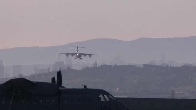 stockvideo's en b-roll-footage met turkish military cargo plane carrying medical supplies for use against the coronavirus pandemic departed on friday for the uk at the direction of... - geproduceerd segment