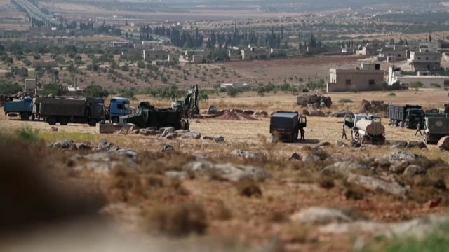 turkish military convoy are seen near the town of maar hitat in syria's nothern idlib province as jihadists and allied rebels withdrew from a key... - jihad stock videos & royalty-free footage
