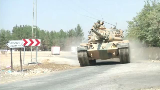 """stockvideo's en b-roll-footage met turkish military tanks and armored vehicles are seen near turkish-syrian border in karkamis district of gaziantep, turkey during the """"operation... - isis"""