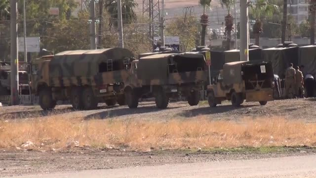 Turkish military vehicles are being transferred to the Syrian border in Reyhanli district of Hatay province southern Turkey on October 20 2017 In...