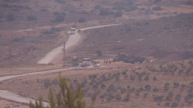 Turkish military vehicles are deployed on the Syrian border in Reyhanli district of Hatay province southern Turkey on October 13 2017 Turkish troops...