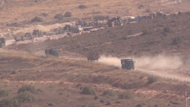 Turkish military vehicles are deployed on the Syrian border in Reyhanli district of Hatay province southern Turkey on October 24 2017 In line with...