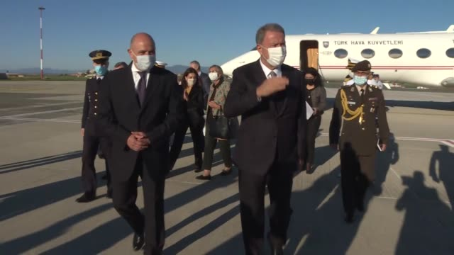 turkish national defense minister hulusi akar is welcomed by turkish ambassador to rome murat selim esenli, turkish ambassador to vatican lutfullah... - ciampino airport video stock e b–roll