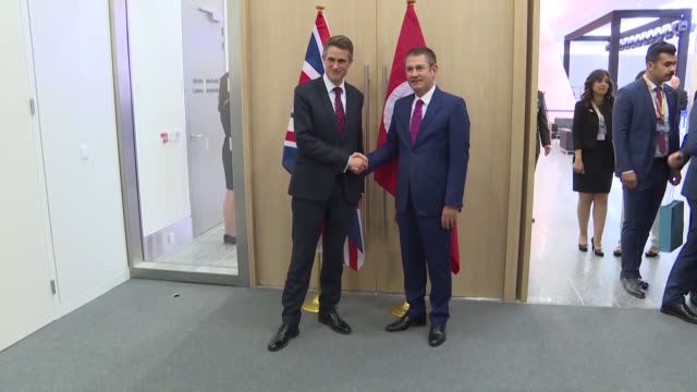 Turkish National Defense Minister Nurettin Canikli meets with British Defense Secretary Gavin Williamson on the sidelines of the NATO defense...