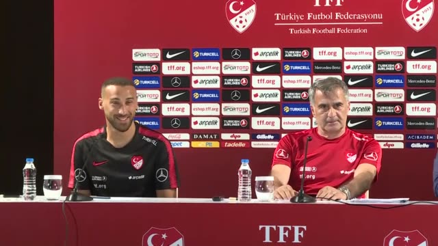 turkish national football team head coach senol gunes and his player cenk tosun attend a press conference on the eve of the international friendly... - senol guenes stock videos and b-roll footage