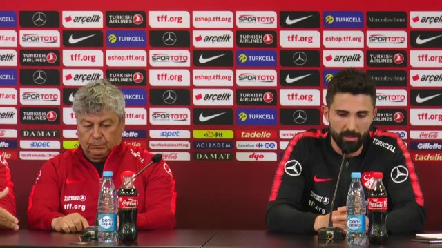 Turkish National Football Team's head coach Mircea Lucescu and his player Hasan Ali Kaldirim attend a press conference on the eve of an international...