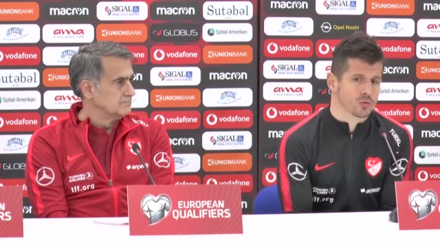 turkish national football team's head coach senol gunes and his player emre belozoglu attend a press conference on the eve of the uefa euro 2020... - senol guenes stock videos and b-roll footage