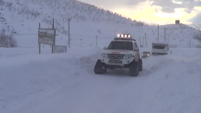 turkish national medical rescue service teams rescued 3 sick people trapped in two separate roads in bingol province due to heavy snow storm on... - aydın province stock videos and b-roll footage