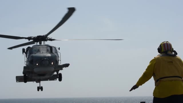 turkish navy s70-b seahawk helicopter lands aboard the blue ridge-class command ship uss mount whitney during exercise baltic operations 2019. - turkish ethnicity stock videos & royalty-free footage