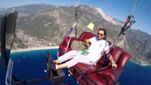 turkish paraglider took to the skies in turkey's southwestern oludeniz neighborhood with a drink snack and tv hasan kaval attached a metalframed red... - red potato stock videos & royalty-free footage