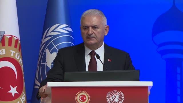 Turkish Parliament Speaker Binali Yildirim speaks at a symposium on migration and integration policies on December 12 2018 in Ankara Turkey Peace...