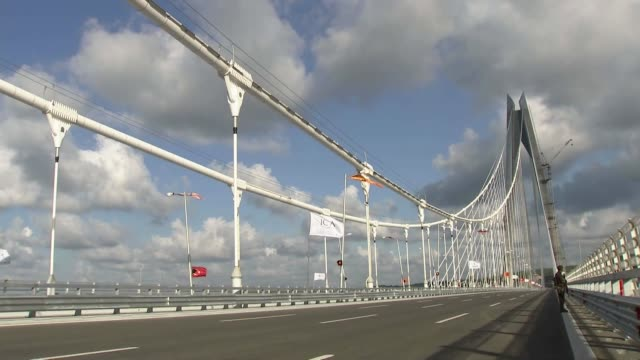 turkish parliament speaker ismail kahraman delivers a speech during the opening ceremony of the yavuz sultan selim bridge in istanbul turkey on... - sultan stock videos and b-roll footage