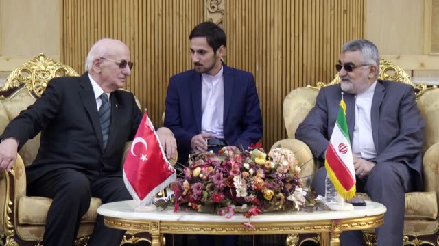 Turkish Parliament Speaker Ismail Kahraman is welcomed by Chairman of the Iranian Parliament's Committee on National Security and Foreign Policy...