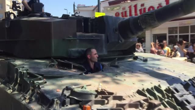 turkish people and police officers are seen over the tank after a group of soldiers with armored vehicle involved in parallel state/gulenist... - armored vehicle stock videos & royalty-free footage