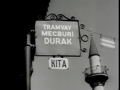 turkish people walking on street. vs signs in turkish 'tramway' advertisement for razor blades endorsed by boxer max baer 'telegraf ' sign for oil.... - ムスタファ ケマル アタテュルク点の映像素材/bロール