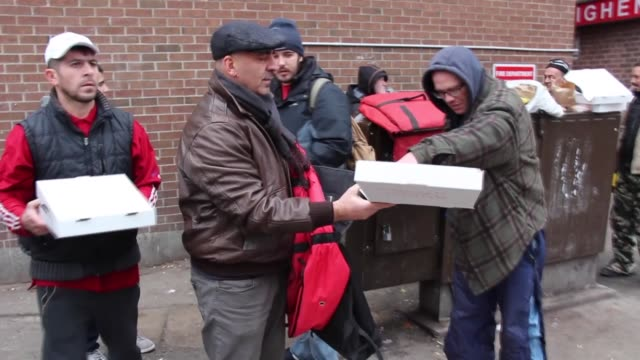 turkish pizza maker living in canada distributed food and winter clothing to the homeless. zeynel ari, who became famous for his wood fire pizzeria... - prime minister stock videos & royalty-free footage
