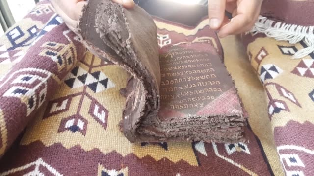 vídeos de stock e filmes b-roll de turkish police recovered an ancient leather manuscript from suspected antiquities traffickers in a central province security sources said on tuesday... - encontrar