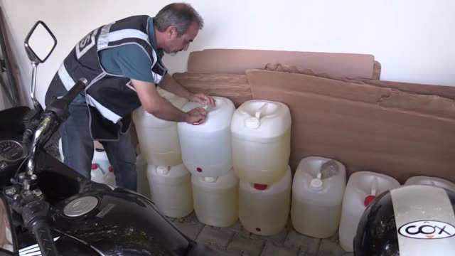 vídeos de stock, filmes e b-roll de turkish police seized more than three tons of smuggled ethanol a key ingredient used to make alcoholic beverages on july 24 2019 in adana turkey also... - etanol