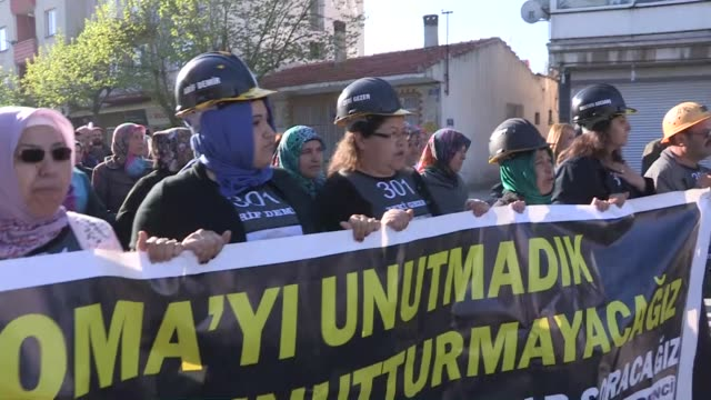 Turkish police take security measures as the relatives of the victims of Soma mining disaster march towards the the Akhisar High Criminal Court where...