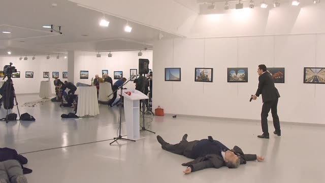 A Turkish policeman crying Aleppo and Allahu Akbar shoots dead Russia's ambassador to Turkey at an art exhibition in Ankara in what Moscow brand a...