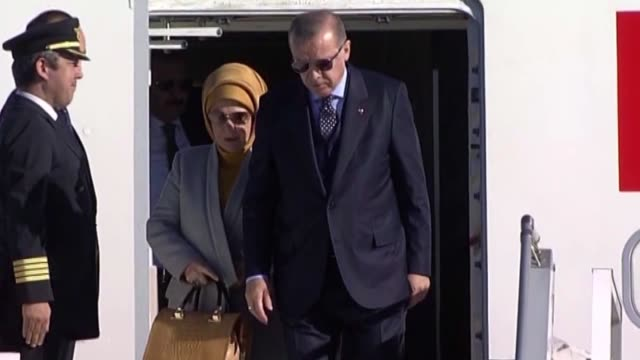 Turkish President Recep Tayyip Erdogan accompanied by First Lady Emine Erdogan are welcomed by Turkish Foreign Minister Mevlut Cavusoglu Greek...