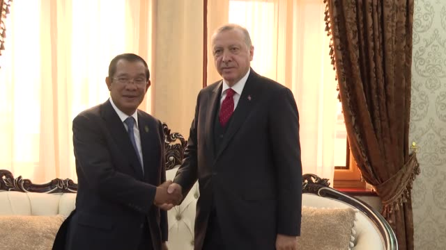 stockvideo's en b-roll-footage met turkish president recep tayyip erdogan and cambodian prime minister hun sen hold a meeting on the sidelines of the 5th summit of heads of state of... - minister president