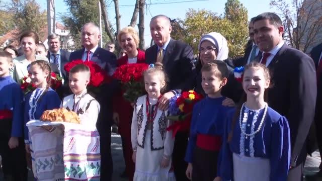 turkish president recep tayyip erdogan and his wife emine erdogan are welcomed by moldavan president igor dodon his wife galina dodon and gagauzia... - moldova stock videos and b-roll footage