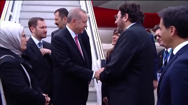 Turkish President Recep Tayyip Erdogan and his wife Emine Erdogan are welcomed by Argentinian Culture Minister Pablo Avelluto upon their arrival for...