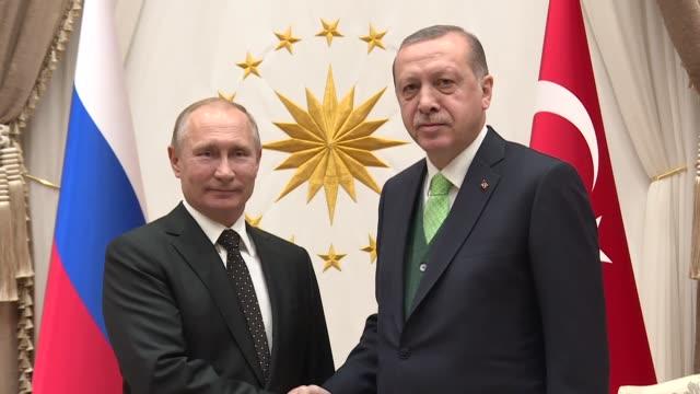 Turkish President Recep Tayyip Erdogan and Russian President Vladimir Putin hold a meeting at presidential complex in Ankara Turkey on December 11...