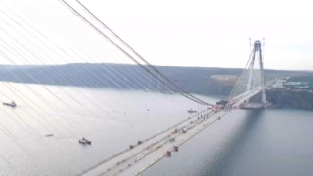 turkish president recep tayyip erdogan and turkish prime minister ahmet davutoglu attend ceremony of installation of the last steel deck on yavuz... - トルコ首相点の映像素材/bロール