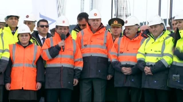 turkish president recep tayyip erdogan and turkish prime minister ahmet davutoglu attend ceremony of installation of the last steel deck on yavuz... - primo ministro turco video stock e b–roll