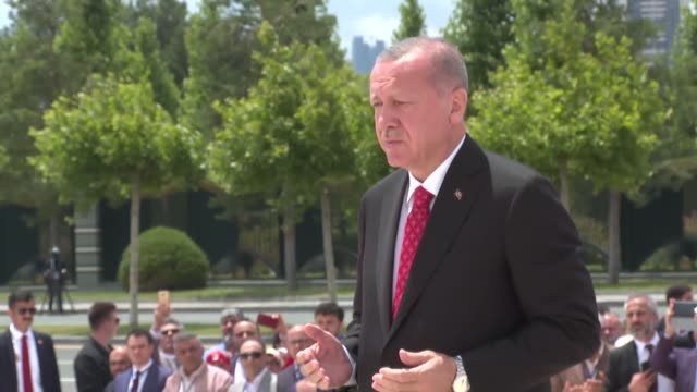 turkish president recep tayyip erdogan attends a wreathlaying ceremony at the july 15 martyrs' monument and walks with turkish parliament speaker... - 民主主義点の映像素材/bロール