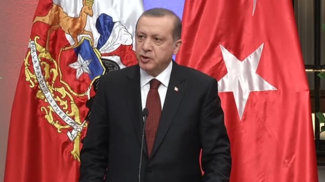 Turkish President Recep Tayyip Erdogan delivers a speech during a joint press conference with Chilean president Michelle Bachelet listen following a...