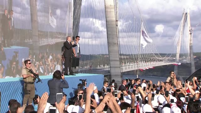 turkish president recep tayyip erdogan delivers a speech during the opening ceremony of the yavuz sultan selim bridge in istanbul turkey on august 26... - sultan stock videos and b-roll footage