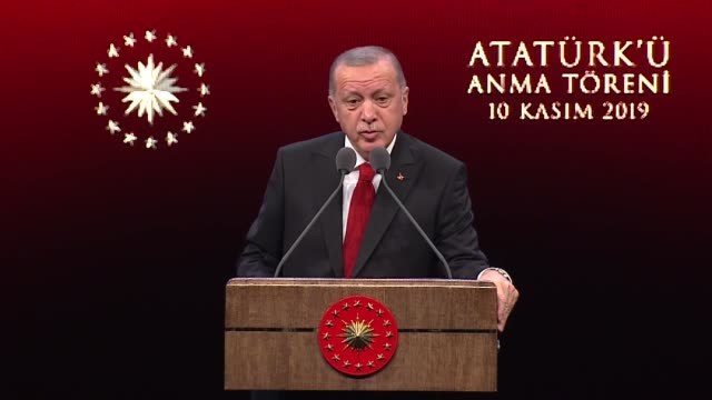 turkish president recep tayyip erdogan gives a speech during a ceremony at bestepe national congress and culture center marking the 81st death... - 1938年点の映像素材/bロール