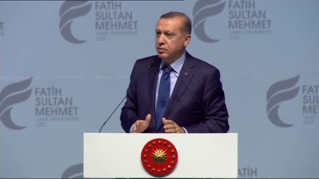 turkish president recep tayyip erdogan gives a speech during a graduation ceremony of fatih sultan mehmet university at halic congress center in... - french doors stock videos and b-roll footage