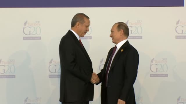 turkish president recep tayyip erdogan greets the leaders during the 'welcoming ceremony' prior to the g20 turkey leaders summit on november 15 2015... - g20 leaders' summit stock videos & royalty-free footage