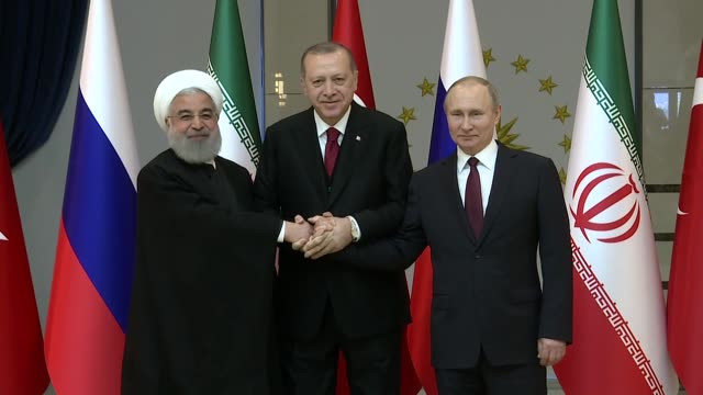 turkish president recep tayyip erdogan iranian president hassan rouhani and russian president vladimir putin pose for photographers prior to the... - wladimir putin stock-videos und b-roll-filmmaterial