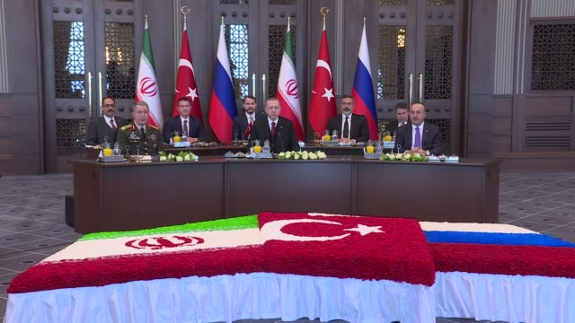 Turkish President Recep Tayyip Erdogan Iranian President Hassan Rouhani and Russian President Vladimir Putin attend a tripartite summit on Syria at...