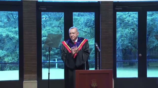 vídeos y material grabado en eventos de stock de turkish president recep tayyip erdogan is awarded an honorary doctorate degree by japan's mukogawa women's university during his visit to the country... - number 9
