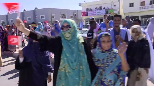turkish president recep tayyip erdogan is welcomed with cheers by mauritanian people upon his arrival at mauritania international nouakchott airport... - ヌアクショット点の映像素材/bロール