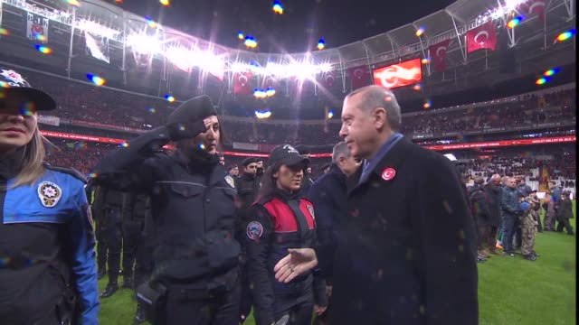 Turkish President Recep Tayyip Erdogan kicks the ball to start the friendly football match held for the martyrs killed during the recent terror...