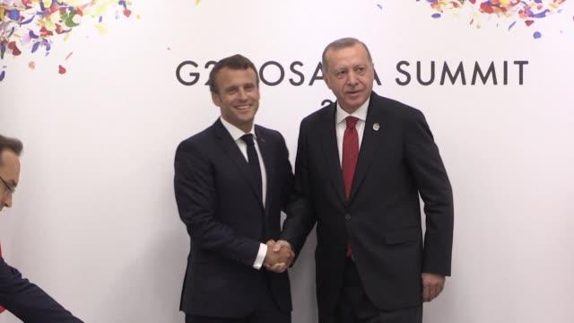 turkish president recep tayyip erdogan meets his french counterpart emmanuel macron during a bilateral meeting at the g20 summit in osaka japan - recep tayyip erdoğan stock videos & royalty-free footage