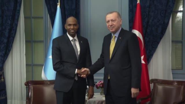 turkish president recep tayyip erdogan meets somalian prime minister hassan ali hayr in the sidelines with global refugee forum in switzerland on... - アフリカの角点の映像素材/bロール