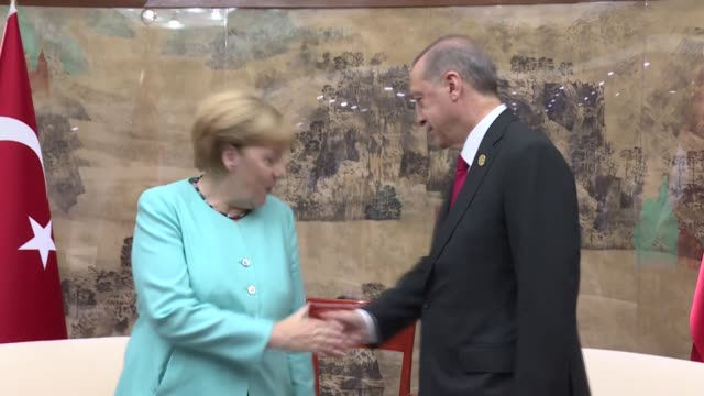turkish president recep tayyip erdogan meets with german chancellor angela merkel ahead of the g20 summit at the grand metropark hotel in the coastal... - group of 20 stock videos & royalty-free footage