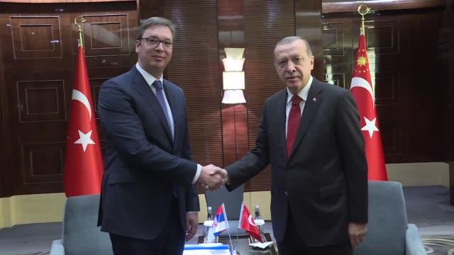 turkish president recep tayyip erdogan meets with his serbian counterpart aleksandar vučić ahead of the belt and road forum in beijing china on may... - ベルト点の映像素材/bロール