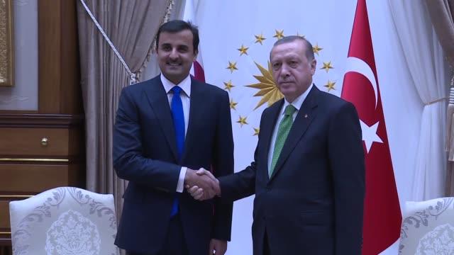 Turkish President Recep Tayyip Erdogan meets with Qatari Emir Sheikh Tamim bin Hamad Al Thani at the presidential complex in Ankara Turkey on...