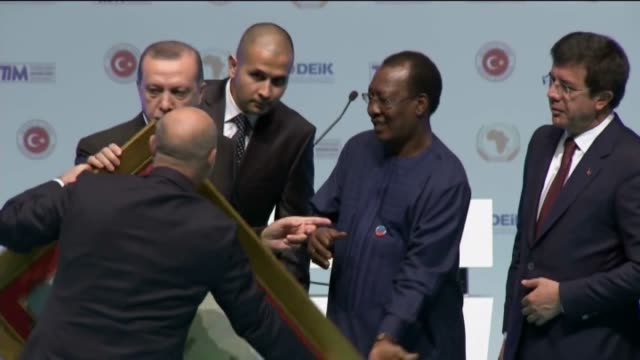 turkish president recep tayyip erdogan presents a gift to president of chad idriss deby during the opening session of the turkey-africa economic and... - 2016 stock videos & royalty-free footage
